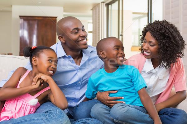 счастливая семья расслабляющая диване домой гостиной человека Сток-фото © wavebreak_media