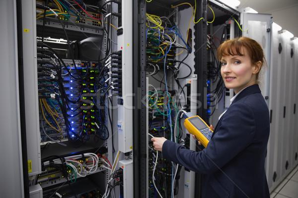 Happy technician using digital cable analyzer on server  Stock photo © wavebreak_media