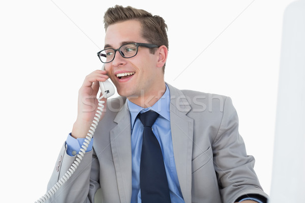 Nerdy businessman talking on phone Stock photo © wavebreak_media
