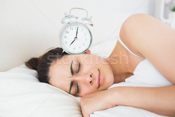 красивая женщина спальный кровать будильник красивой Сток-фото © wavebreak_media