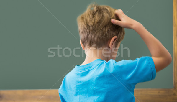 Thinking pupil scratching his head in classroom Stock photo © wavebreak_media
