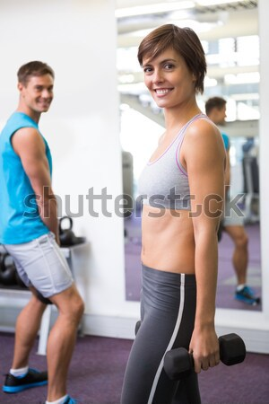 Personal trainer and client smiling at camera Stock photo © wavebreak_media