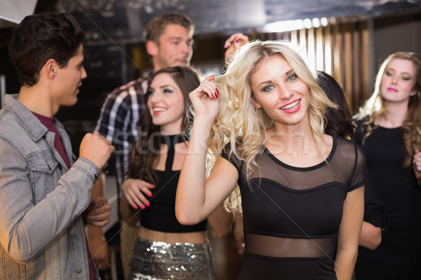 Stylish blonde smiling at camera Stock photo © wavebreak_media