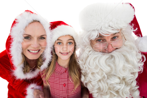 Santa and Mrs Claus smiling at camera with little girl Stock photo © wavebreak_media
