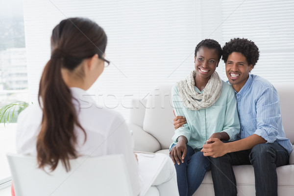 Reconciled couple smiling at their therapist Stock photo © wavebreak_media