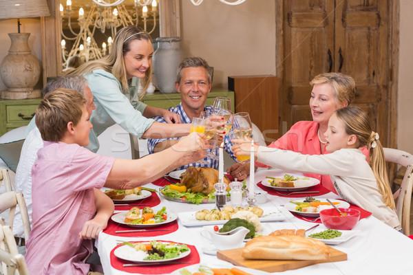 Three generation family enjoying christmas dinner together Stock photo © wavebreak_media