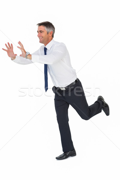 Felice imprenditore giacca qualcosa bianco business Foto d'archivio © wavebreak_media