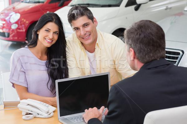 Smiling couple buying a new car Stock photo © wavebreak_media