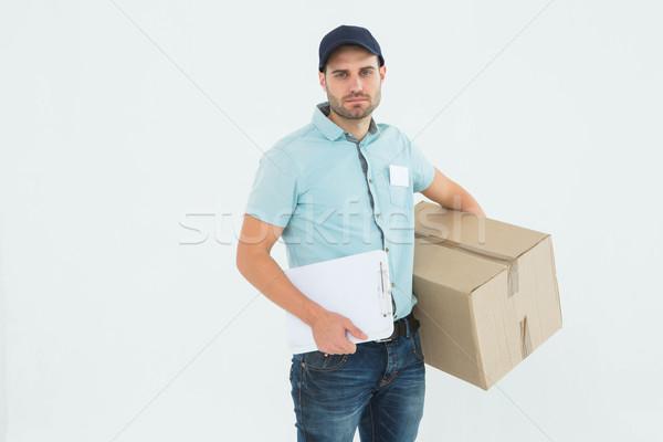 Triste mensajero portapapeles paquete retrato blanco Foto stock © wavebreak_media