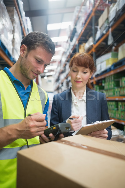 Worker and manager scanning package in warehouse Stock photo © wavebreak_media