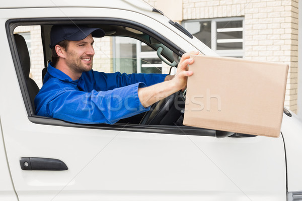 Delivery driver offering parcel from his van Stock photo © wavebreak_media