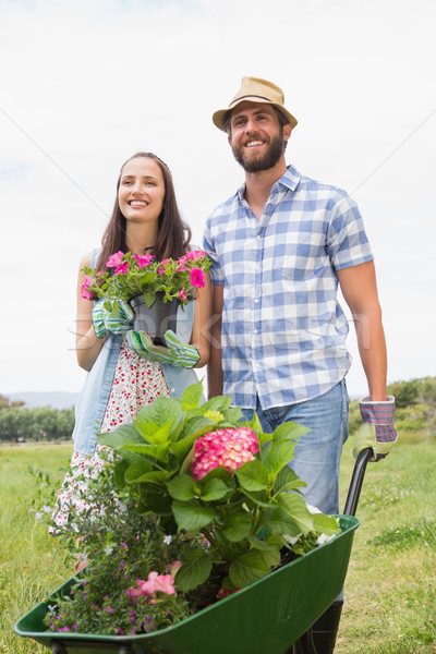 Stock photo: Happy young couple gardening together