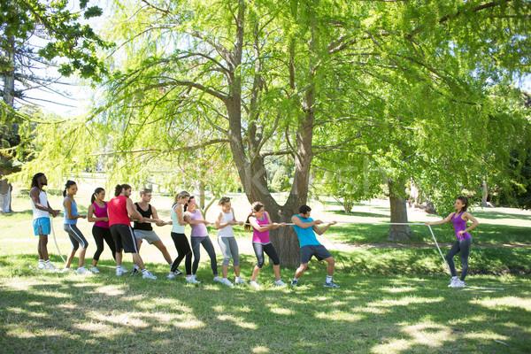 Fitness group playing tug of war Stock photo © wavebreak_media
