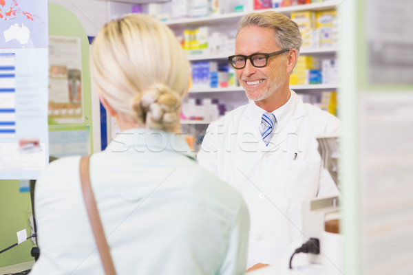 Senior pharmacist speaking with customer Stock photo © wavebreak_media