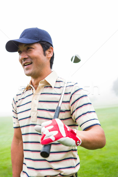 Smiling golfer standing and holding his club  Stock photo © wavebreak_media