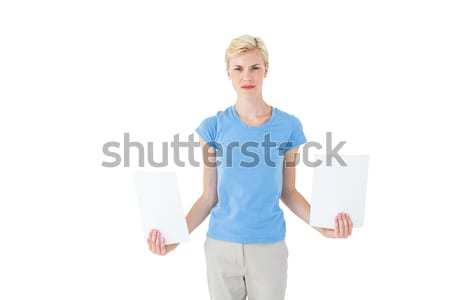Stern blonde woman holding sheets of paper  Stock photo © wavebreak_media
