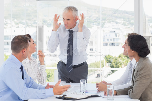 Irritated businessman talking to his team Stock photo © wavebreak_media