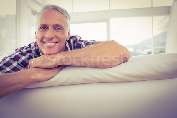 Turned back businessman smiling at the camera Stock photo © wavebreak_media