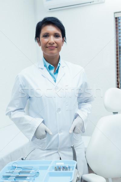 улыбаясь женщины стоматолога рук портрет Постоянный Сток-фото © wavebreak_media