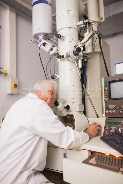 Biochemist using large microscope and computer Stock photo © wavebreak_media