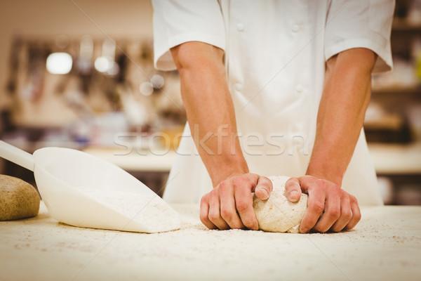 Baker kneading dough at a counter Stock photo © wavebreak_media