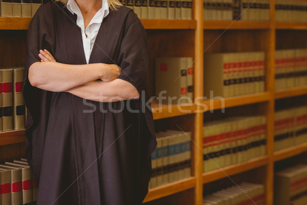 Lawyer leaning on shelf with arms crossed  Stock photo © wavebreak_media