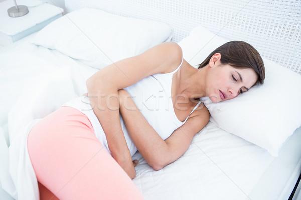 Mooie brunette lijden maag pijn home Stockfoto © wavebreak_media