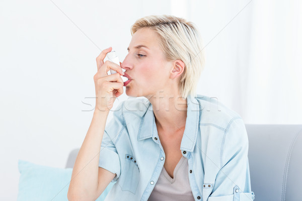 Pretty blonde woman using her inhaler Stock photo © wavebreak_media