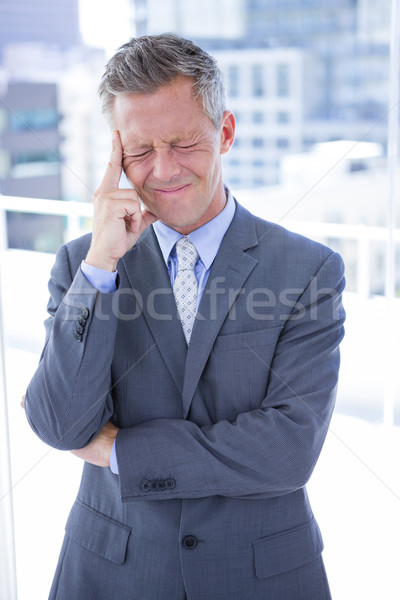 Businessman having a headache Stock photo © wavebreak_media
