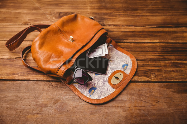 Sunglasses and wallet on the vintage bag Stock photo © wavebreak_media
