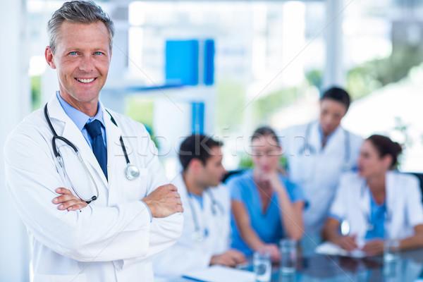 врач улыбаясь камеры коллеги за медицинской Сток-фото © wavebreak_media