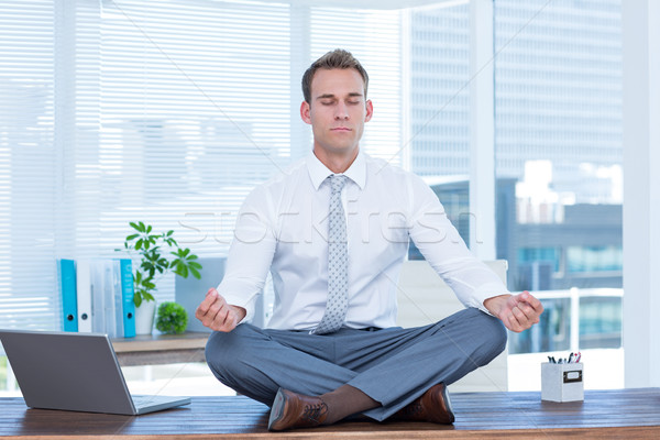Zen imprenditore yoga meditazione desk business Foto d'archivio © wavebreak_media