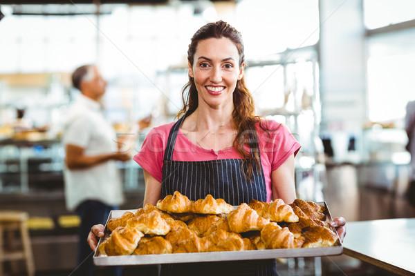 Baker showing tray of fresh croissant Stock photo © wavebreak_media