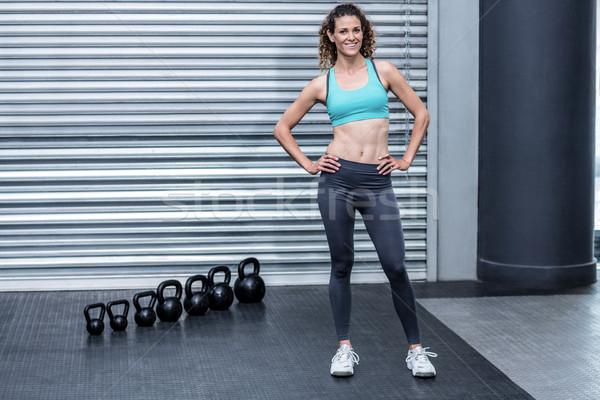 立って 筋肉の 女性 手 ヒップ 健康 ストックフォト © wavebreak_media
