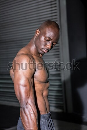 Young Bodybuilder in a hoodie looking at the camera totally surp Stock photo © wavebreak_media