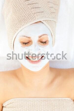 Smiling woman having white cream on her face  Stock photo © wavebreak_media