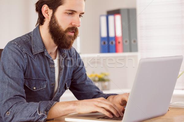 Hipster businessman working at his desk Stock photo © wavebreak_media