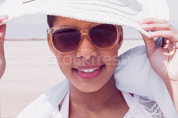 Stylish woman in hat and sunglasses Stock photo © wavebreak_media