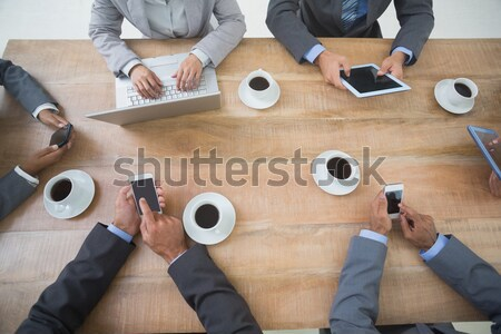 Smiling friends chatting and drinking coffee Stock photo © wavebreak_media