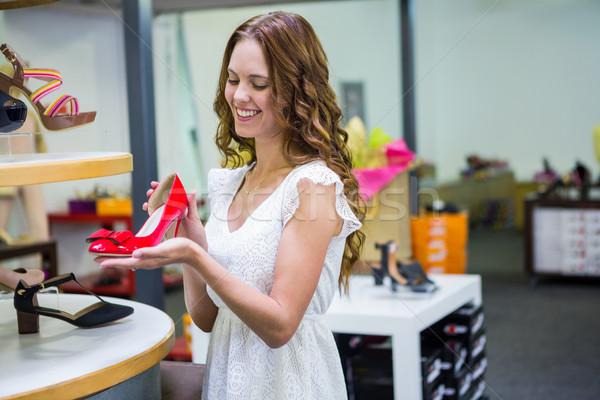 Pretty woman shopping for shoes Stock photo © wavebreak_media