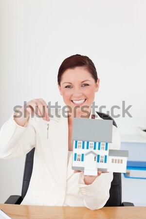 Volunteer holding clipboard against white background Stock photo © wavebreak_media