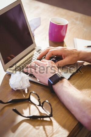 Person using Tablet with Shopping trolley icon Stock photo © wavebreak_media