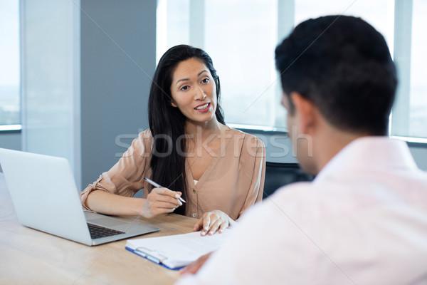деловая женщина договор мужчины коллега заседание Сток-фото © wavebreak_media