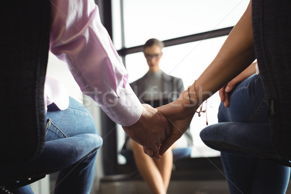 Mid section of couple holding hands Stock photo © wavebreak_media