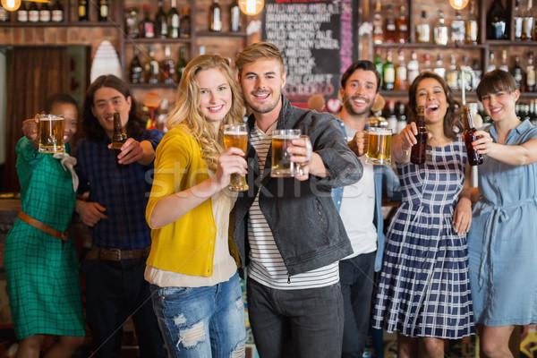 Vrolijk vrienden bier bril pub Stockfoto © wavebreak_media