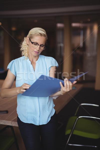 Stock photo: Attentive executive reading file