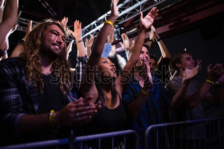 Low angle view of fans enjoying at nightclub Stock photo © wavebreak_media
