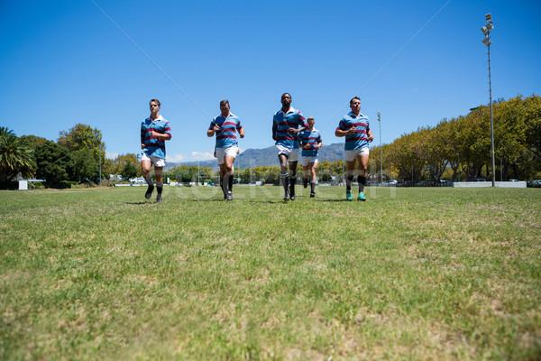 Confident rugby team running at field Stock photo © wavebreak_media