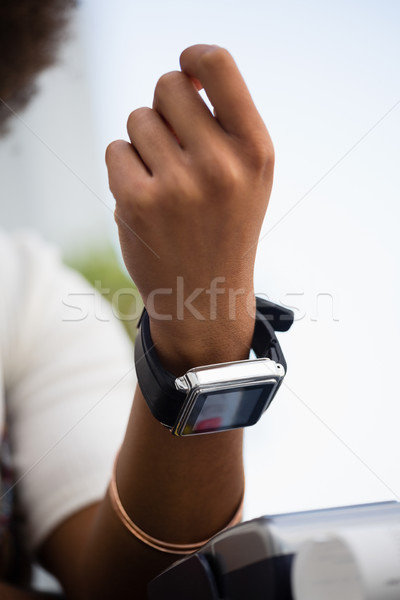 Mid section of woman making payment with smart watch Stock photo © wavebreak_media
