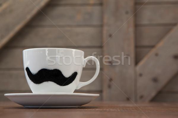 Taza platillo falso bigote Foto stock © wavebreak_media